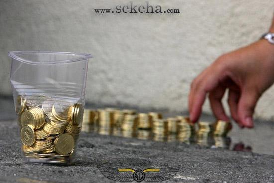 سنگ فرش خیابان با سکه